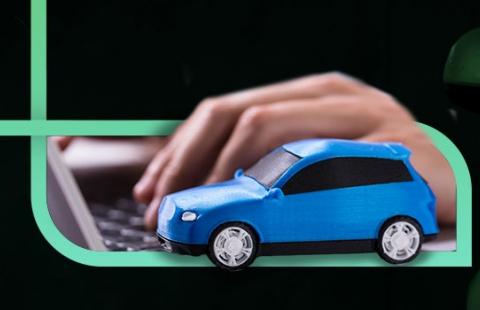 banner com foto de um carro azul próximo de um mão